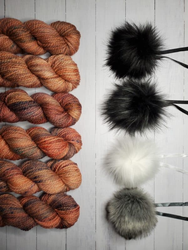 indie dyed yarn paired with luxurious pom pom
