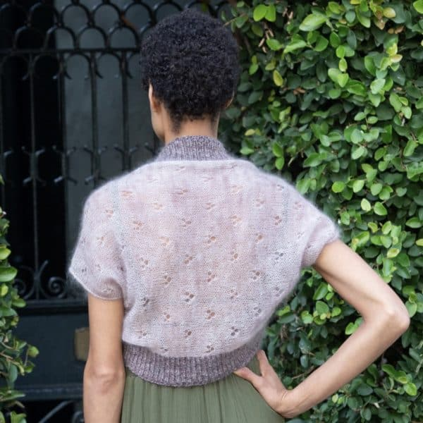 Pale purple shrug knit in mohair and merino-cashmere-nylon yarn, worn by a Black woman and shown from the back.