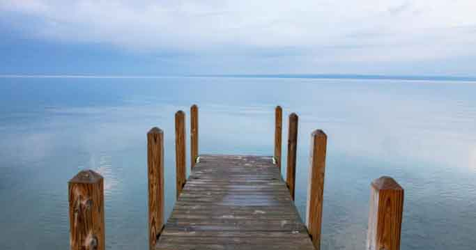A dock on Lake Superior in Michigan the location for Issue 7 of Nomadic Knits knitting magazine