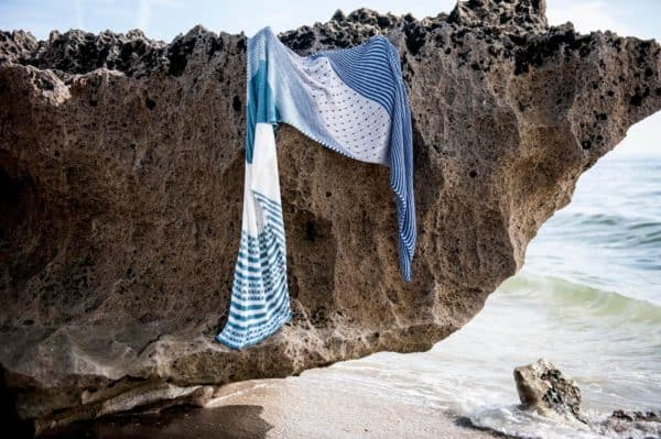 Shawl hanging from rock on the beach