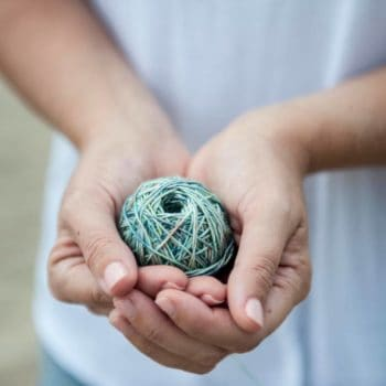 Hands holding a ball of yarn