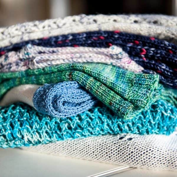 Knit garments folded and stacked