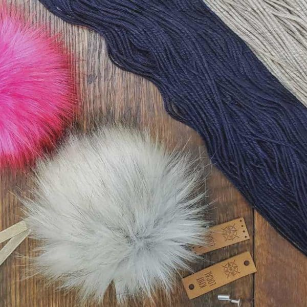 hand dyed yarn with pom pom and knitwear tag