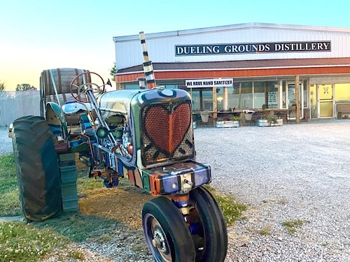 Painted tractor in front of micro-distillery