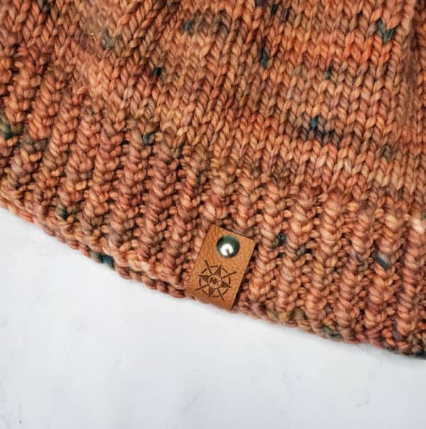 lonely hearts hat with riveted project tag indie dyed yarn michigan