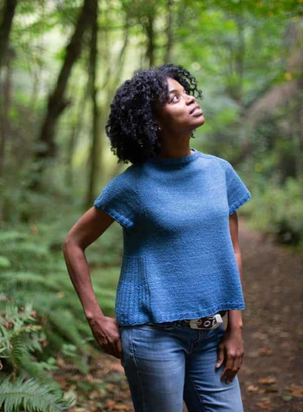 woman in knit t-shirt in forest