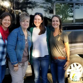 Becky and Melissa in front of van with Olive and Two crew