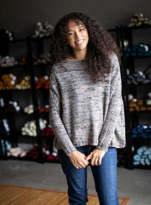 Kayla Maressa modeling a cozy grey sweater knit in Magpie Fibers. The knitting pattern is by Melissa Kemmerer in issue four of Nomadic Knits boutique knitting magazine