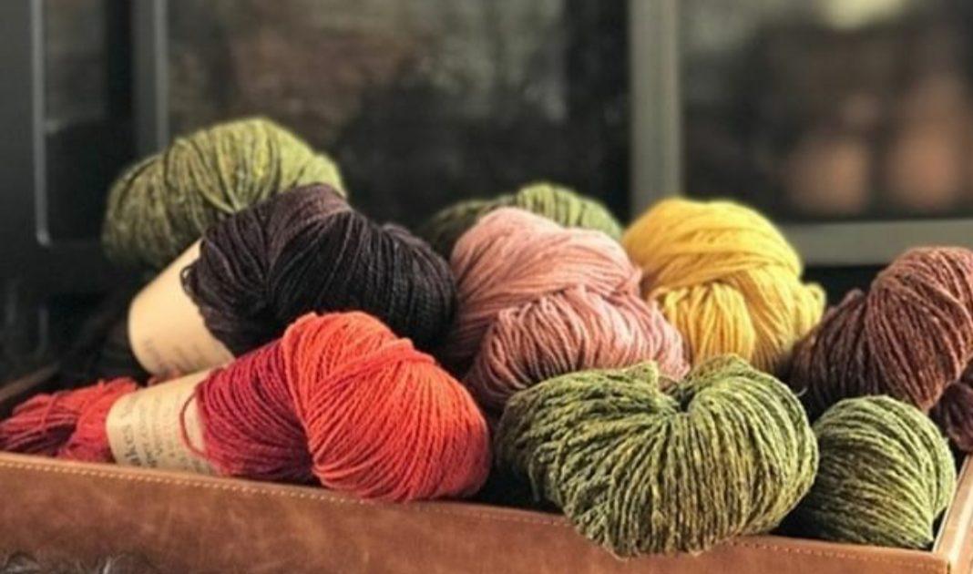 A pile of beautiful yarn in Nomadic Knits creative knitting magazine